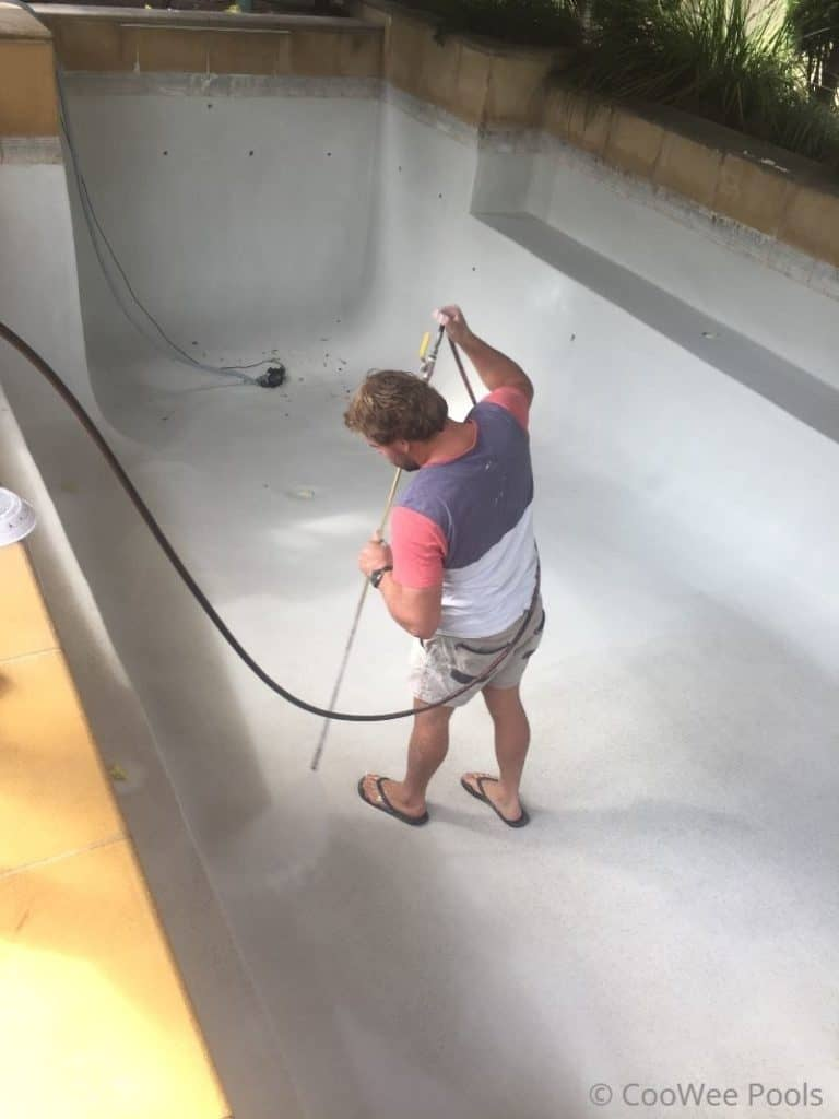 washing new pool interior