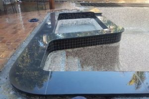 hand cut and shaped bluestone coping on a rectangular pool and spa