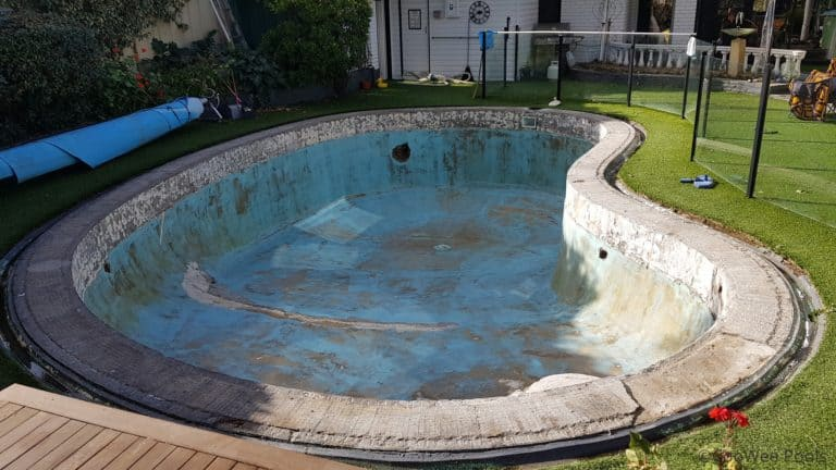 Mt Eliza pool with waterline tiles and coping tiles removed